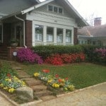 A spring season photo of the exterior front of a 1926 bungalow home in Atlanta's Virginia-Highland neighborhood