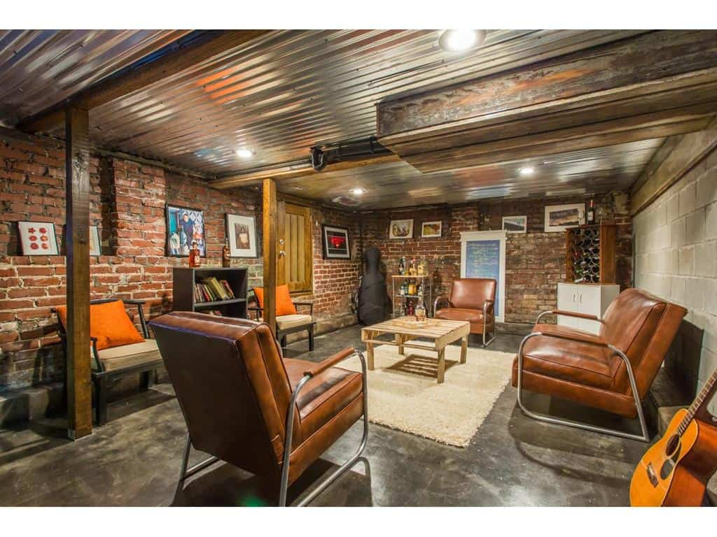Perfect Man Cave with tin ceiling, exposed brick in this Atlanta Old Fourth Ward Bungalow